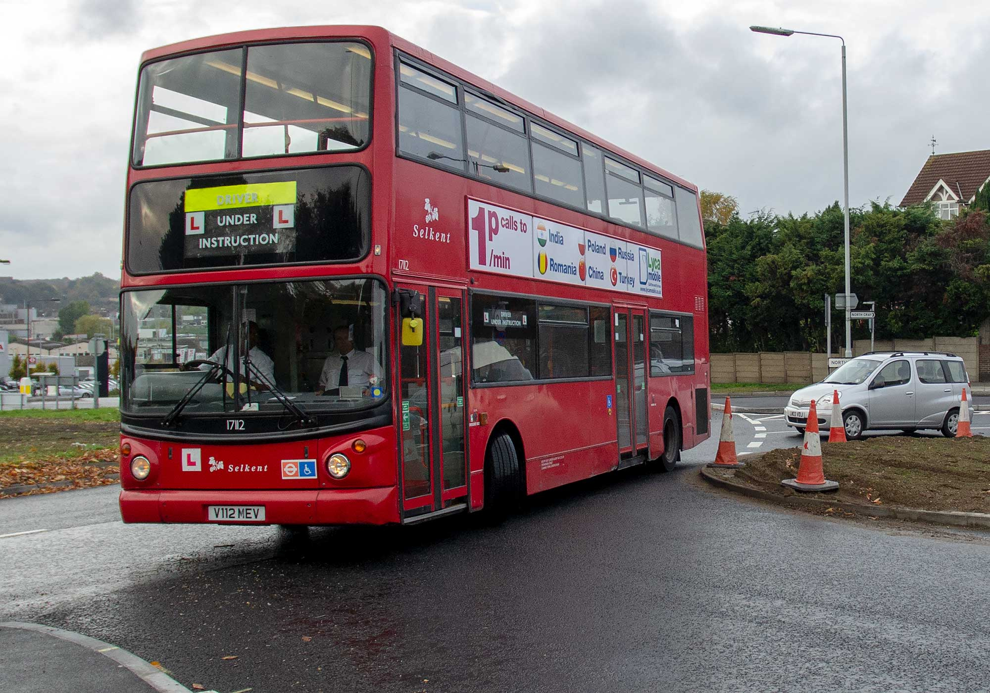 Bus attempts to get around Ruxley roundabout